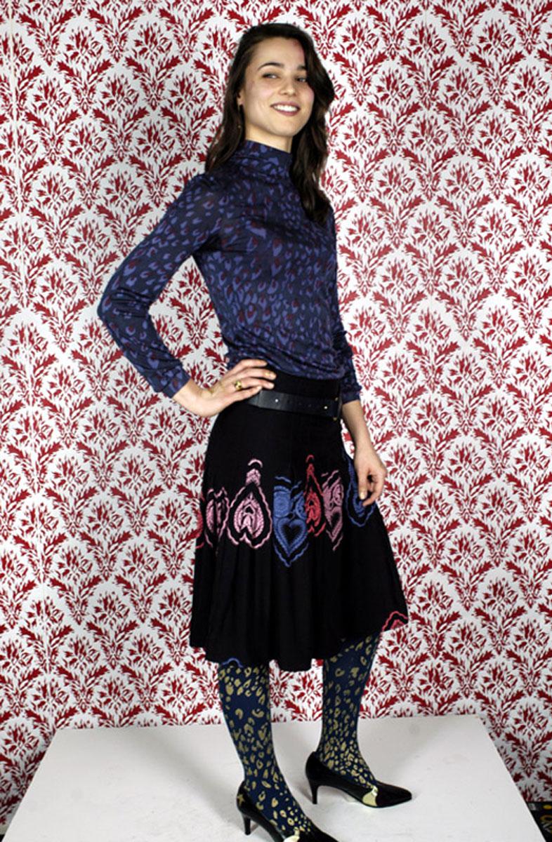 Silk jersey top: <em>Leopard</em> print. Silk skirt: <em>Love Doily</em> print Nylon tights: <em>Leopard</em> print. Leather